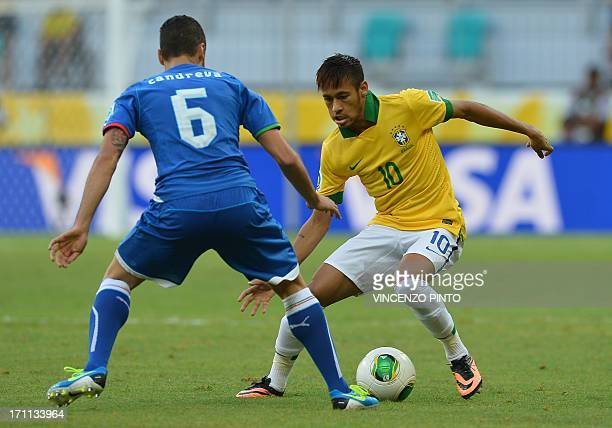 Italy's midfielder Antonio Candreva tries to mark Brazil's forward Neymar during their FIFA Confederations Cup Brazil 2013 Group A football match at...
