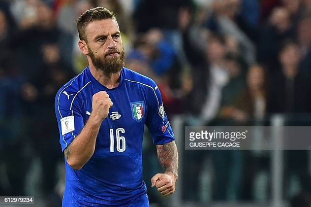 Italy's midfielder Daniele De Rossi celebrates after scoring a penalty during the WC 2018 football qualification match between Italy and Spain on...