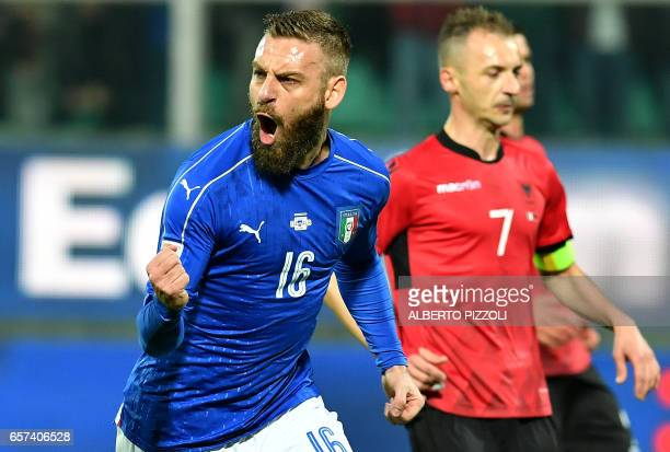 Italy's midfielder Daniele De Rossi celebrates after scoring a penalty during the FIFA World Cup 2018 qualification football match between Italy and...