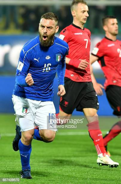 Italy's midfielder Daniele De Rossi celebrates after scoring a penalty during the World Cup 2018 group G qualification football match Italy vs...