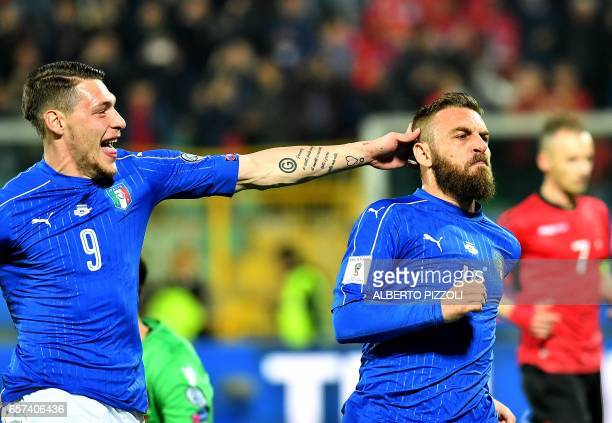 Italy's midfielder Daniele De Rossi celebrates with Italy's forward Andrea Belotti after scoring a penalty during the FIFA World Cup 2018...