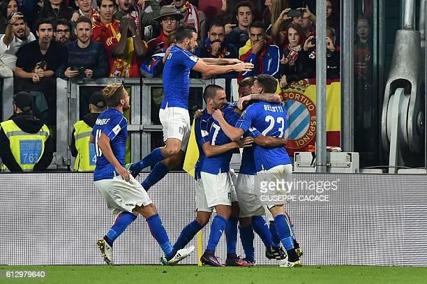 Italy's midfielder Daniele De Rossi celebrates with teammates Italy's forward Andrea Belotti Italy's midfielder Riccardo Montolivo Italy's defender...