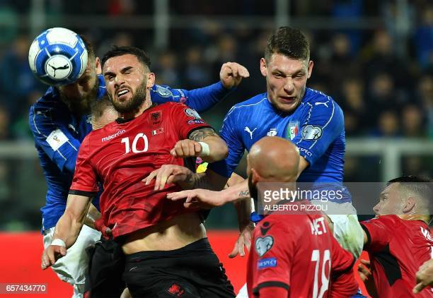 Italy's midfielder Daniele De Rossi fights for the ball with Albania's midfielder Jahmir Hyka next to Italy's forward Andrea Belotti during the FIFA...