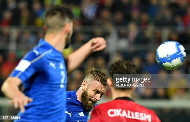 Italy's midfielder Daniele De Rossi heads the ball during the FIFA World Cup 2018 qualification football match between Italy and Albania on March 24...
