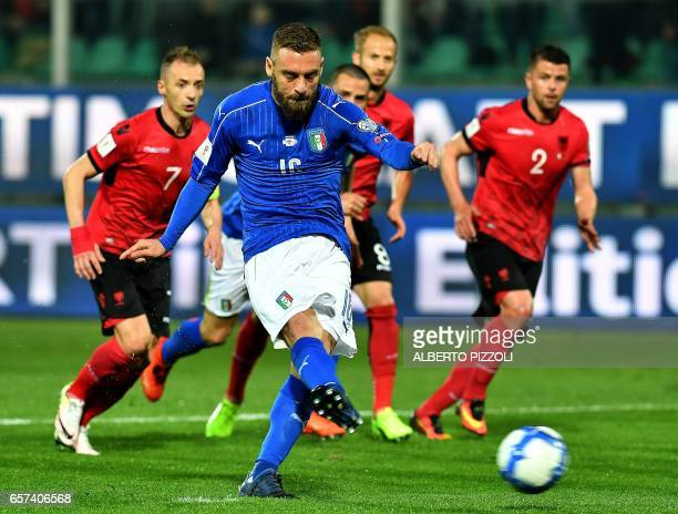 Italy's midfielder Daniele De Rossi scores a penalty during the FIFA World Cup 2018 qualification football match between Italy and Albania on March...