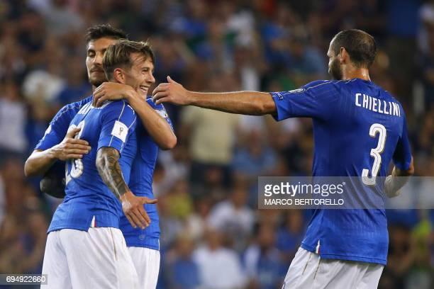 Italy's midfielder Federico Bernardeschi celebrates after scoring with his teammates Italy's midfielder Lorenzo Pellegrini and Italy's defender...