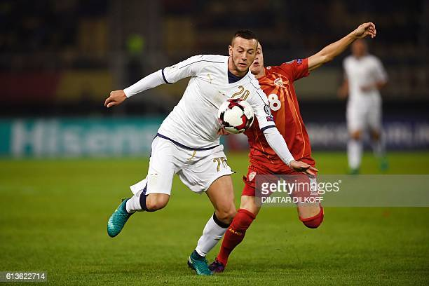 Italy's midfielder Federico Bernardeschi vies wit Macedonia's midfielder Ezgjan Alioski during the FIFA World Cup 2018 qualifying football match...