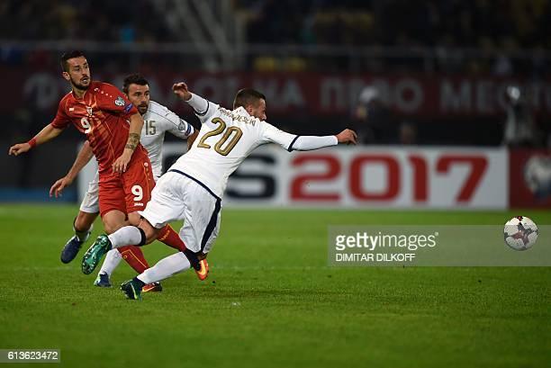 Italy's midfielder Federico Bernardeschi vies with Macedonia's forward Ilija Nestorovski during the FIFA World Cup 2018 qualifying football match...