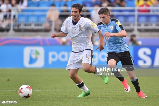 Italy's midfielder Francesco Cassata and Uruguay's midfielder Federico Valverde compete for the ball during the U20 World Cup third place playoff...