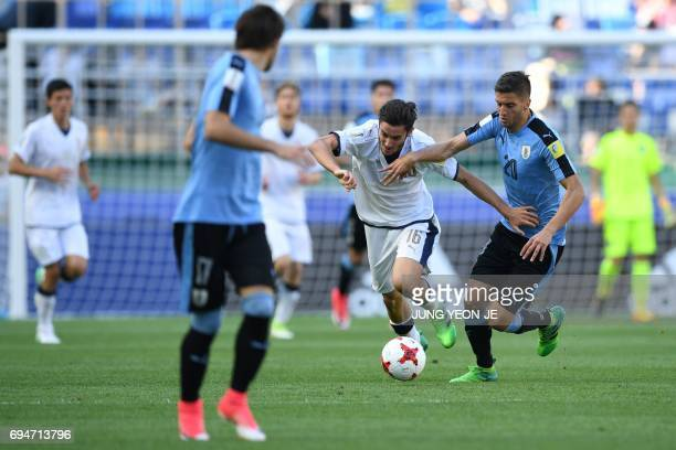Italy's midfielder Francesco Cassata and Uruguay's midfielder Rodrigo Bentancur compete for the ball during the U20 World Cup third place playoff...