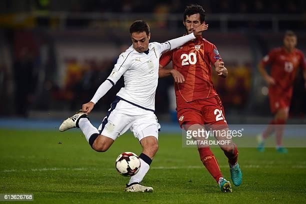 Italy's midfielder Giacomo Bonaventura vies with Macedonia's midfielder Stefan Spirovski during the FIFA World Cup 2018 qualifying football match...