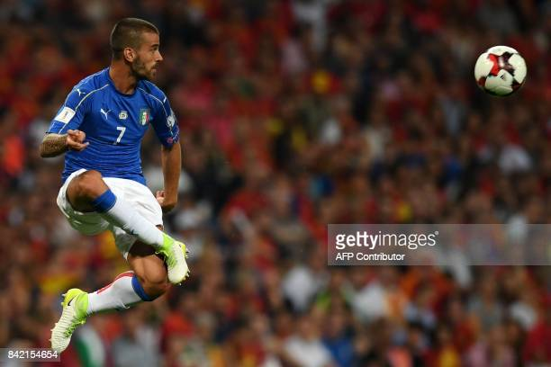 Italy's midfielder Leonardo Spinazzola kicks the ball during the World Cup 2018 qualifier football match Spain vs Italy at the Santiago Bernabeu...