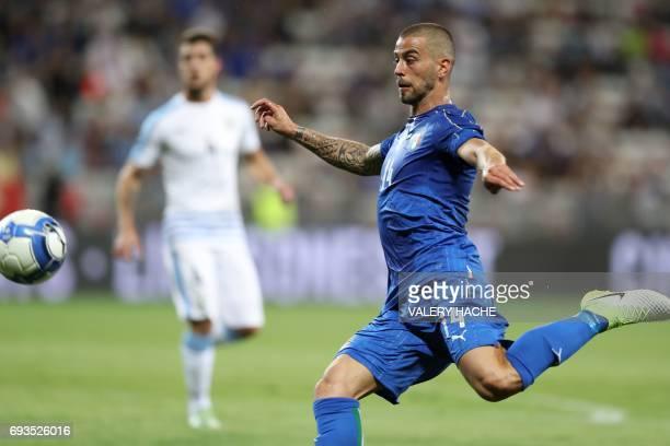 Italy's midfielder Leonardo Spinazzola shoots the ball during the friendly football match Italy vs Uruguay at the Allianz Riviera Stadium in Nice...
