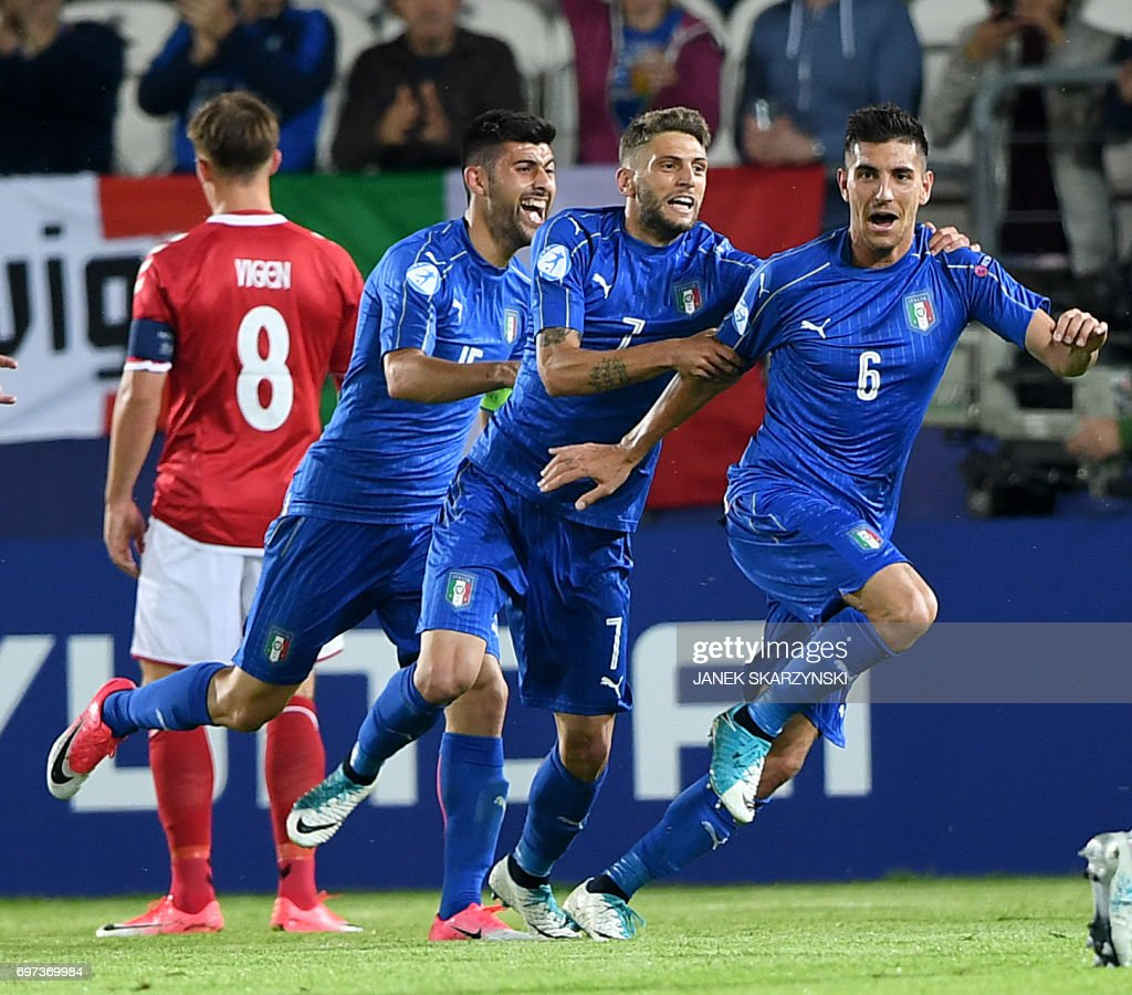 Italy's midfielder Lorenzo Pellegrini celebrates scoring the opening goal with his teammates forward Domenico Berardi and midfielder Marco Benassi during the UEFA U-21 European Championship Group C football match Denmark v Italy in Krakow, Poland on June 18, 2017. /