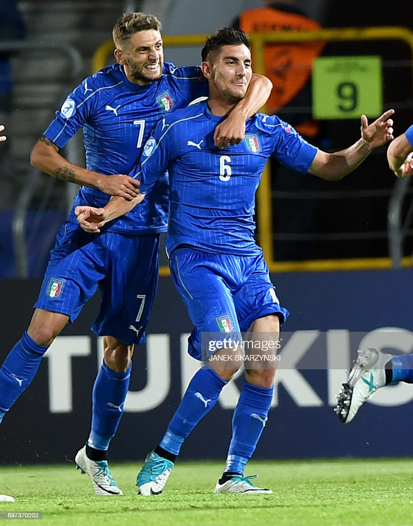Italy's midfielder Lorenzo Pellegrini celebrates scoring the opening goal with his teammate forward Domenico Berardi during the UEFA U-21 European Championship Group C football match Denmark v Italy in Krakow, Poland on June 18, 2017. /