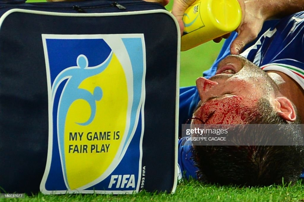 Italy's midfielder Manuel Pasqual lies injured during the FIFA World Cup Qualifying group match Italy Vs Czech Republic on September 10, 2013 at Juventus Stadium in Turin. AFP PHOTO / GIUSEPPE CACACE