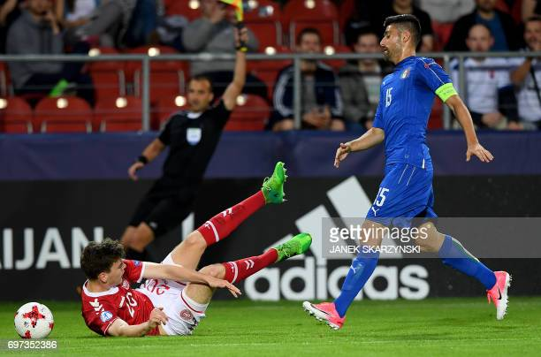 Italy's midfielder Marco Benassi and Denmark's defender Jacob Rasmussen vie for the ball during the UEFA U21 European Championship Group C football...
