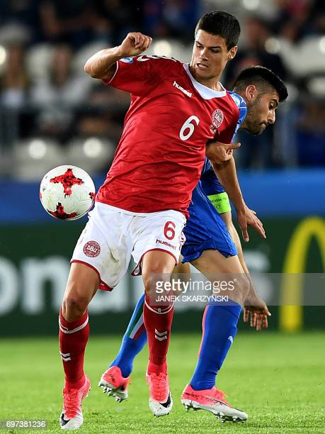 Italy's midfielder Marco Benassi and Denmark's midfielder Christian Norgaard vie for the ball during the UEFA U21 European Championship Group C...