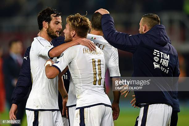 Italy's midfielder Marco Parolo and Italy's forward Ciro Immobile celebrate with their teammates after winning the FIFA World Cup 2018 qualifying...
