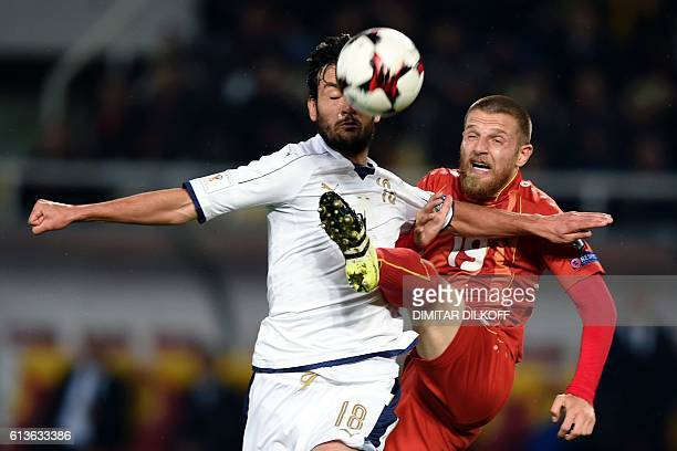 Italy's midfielder Marco Parolo vies with Macedonia's midfielder Milovan Petrovic during the FIFA World Cup 2018 qualifying football match between...
