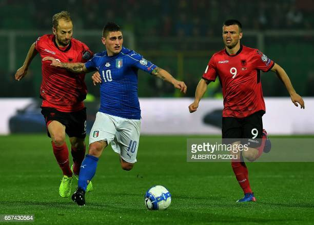 Italy's midfielder Marco Veratti fights for the ball with Albania's defender Naser Aliji and Albania's midfielder Ledian Memushaj during the FIFA...
