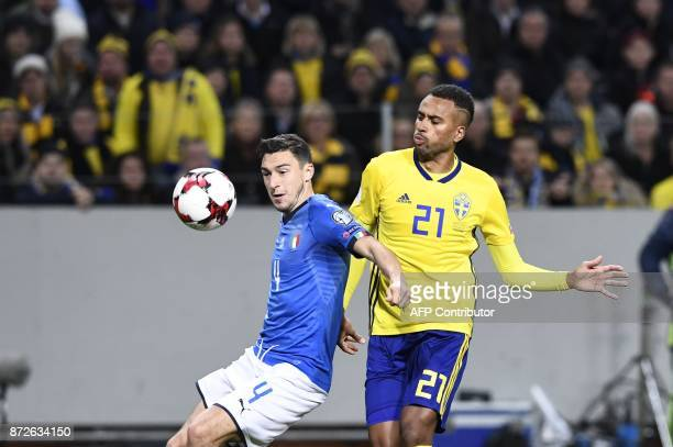 Italy's midfielder Matteo Darmian and Sweden's forward Isaac Kiese Thelin vie for the ball during the FIFA World Cup 2018 qualification football...