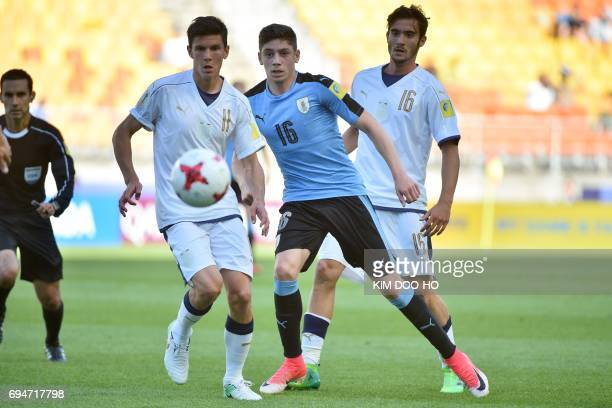 Italy's midfielder Matteo Pessina Uruguay's midfielder Federico Valverde and Italy's midfielder Francesco Cassata watch the ball during the U20 World...