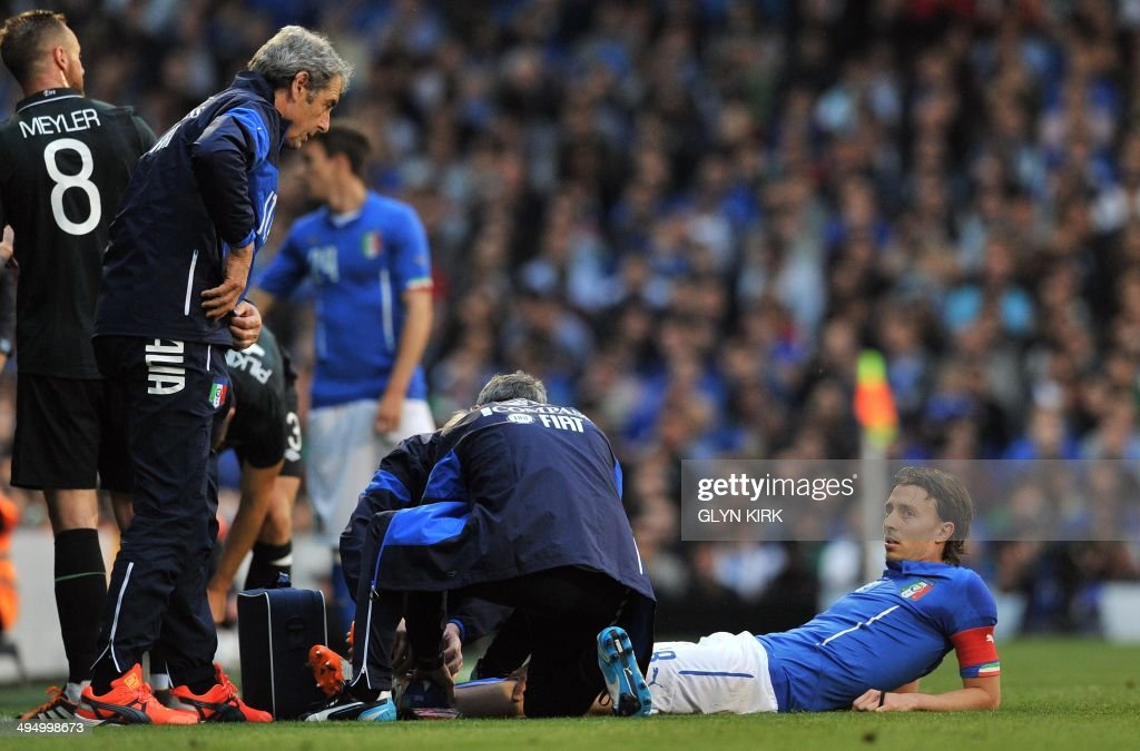 Italy's midfielder Riccardo Montolivo lies injured during the international friendly football match between Italy and Republic of Ireland at Craven Cottage in London on May 31, 2014.