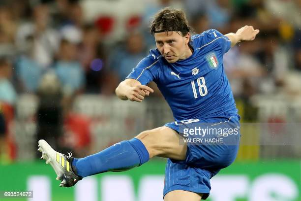 Italy's midfielder Riccardo Montolivo shoots the ball during the friendly football match Italy vs Uruguay at the Allianz Riviera Stadium in Nice...
