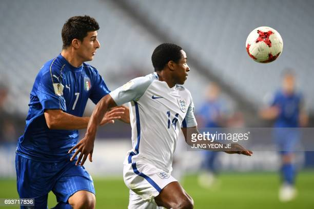 Italy's midfielder Riccardo Orsolini and England's defender Kyle WalkerPeters compete for the ball during the U20 World Cup semifinal football match...