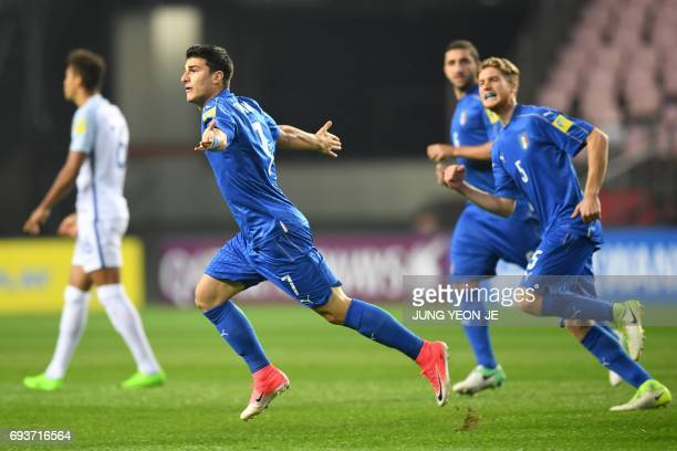 Italy's midfielder Riccardo Orsolini celebrates his goal during the U20 World Cup semifinal football match between England and Italy in Jeonju on...