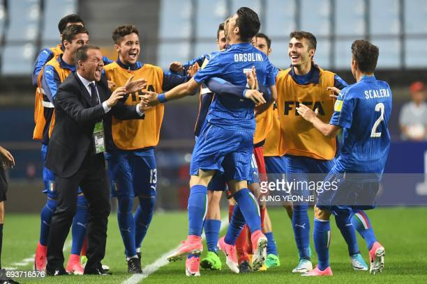 Italy's midfielder Riccardo Orsolini celebrates his goal with teammates during the U20 World Cup semifinal football match between England and Italy...