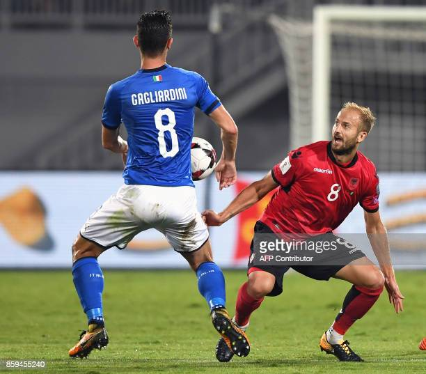 Italy's midfielder Roberto Gagliardini vies with Albania's midfielder Migjen Basha during the FIFA World Cup 2018 qualification football match...