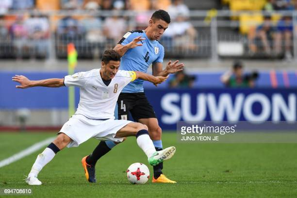 Italy's midfielder Rolando Mandragora and Uruguay's defender Jose Luis Rodriguez compete for the ball during the U20 World Cup third place playoff...