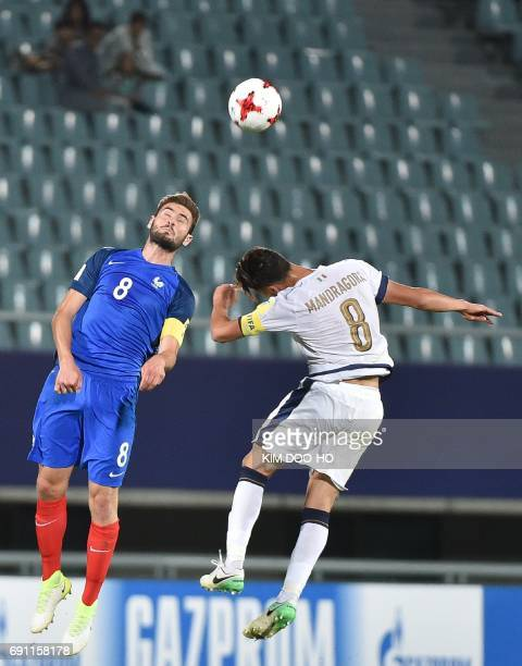 Italy's midfielder Rolando Mandragora fights for the ball with France's midfielder Lucas Tousart during their U20 World Cup round of 16 football...