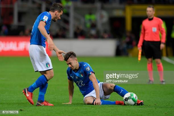 Italy's midfielder Stephan El Shaarawy reacts next to Italy's midfielder Alessandro Florenzi during the FIFA World Cup 2018 qualification football...