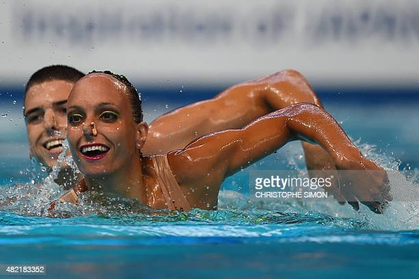 Italy's mixed duet Manila Flamini and Giorgio Minisini compete in the Mixed duet Free preliminary event during the synchronised swimming competition...
