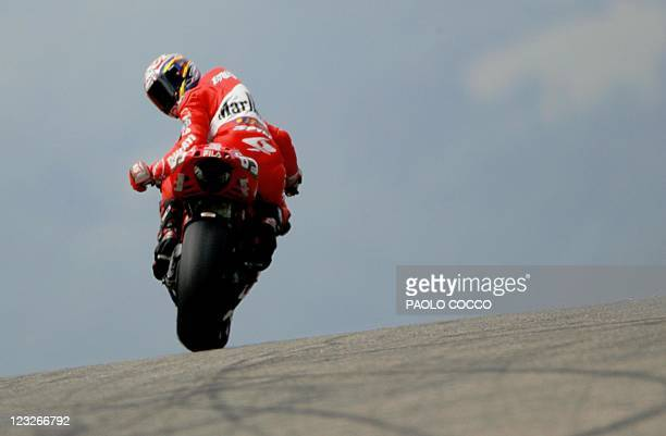 Italy's Moto GP rider Loris Capirossi looks back during a free practice session with his Ducati ahead of the Italian Grand Prix at Mugello's track 05...