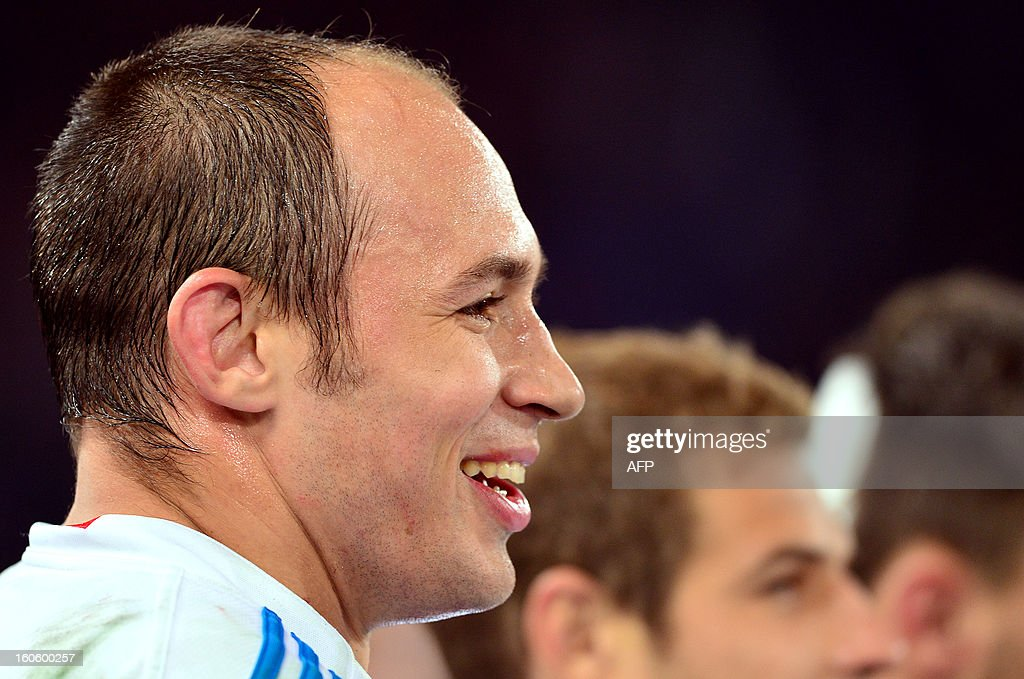 Italy's N°8 and captain Sergio Parisse celebrates after the Six Nations International Rugby Union match between Italy and France at the Olympic Stadium in Rome on February 3, 2013. Italy defeated France 23-18.