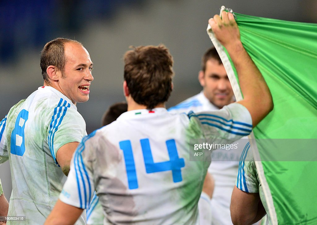 Italy's N°8 and captain Sergio Parisse (L) celebrates with teammates after the Six Nations international rugby union match Italy vs France in Rome's Olimpic Stadium on February 3, 2013. Italy defeated France 23-18.