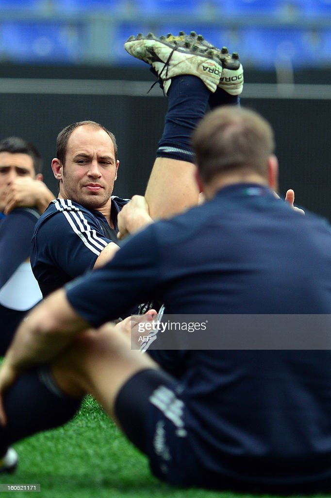 Italy's N°8 and captain Sergio Parisse warms-up during the captain's run on the eve of the Six Nations International Rugby Union match between Italy and France at the Olympic Stadium in Rome on February 2, 2013,.