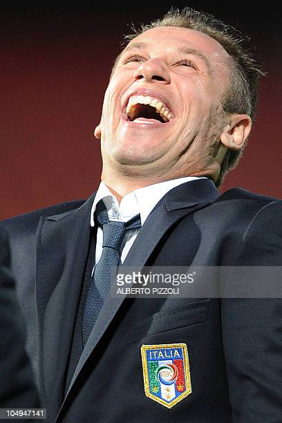 Italy's national football team forward Atonio Cassano laughs as arrives for a visit at Windsor Park stadium on the eve of group C qualifying football...