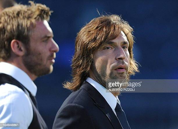 Italy's national football team players midfielder Andrea Pirlo and midfielder Daniele De Rossi arrives for a visit at Windsor Park stadium on the eve...