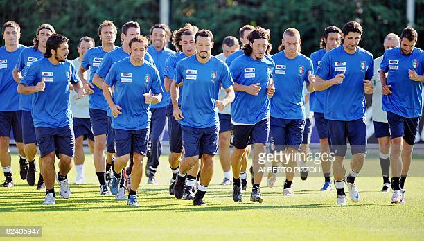 Italy's national football team players warm up Florence on August 18 2008 during the team training session at the National Technical Center of...
