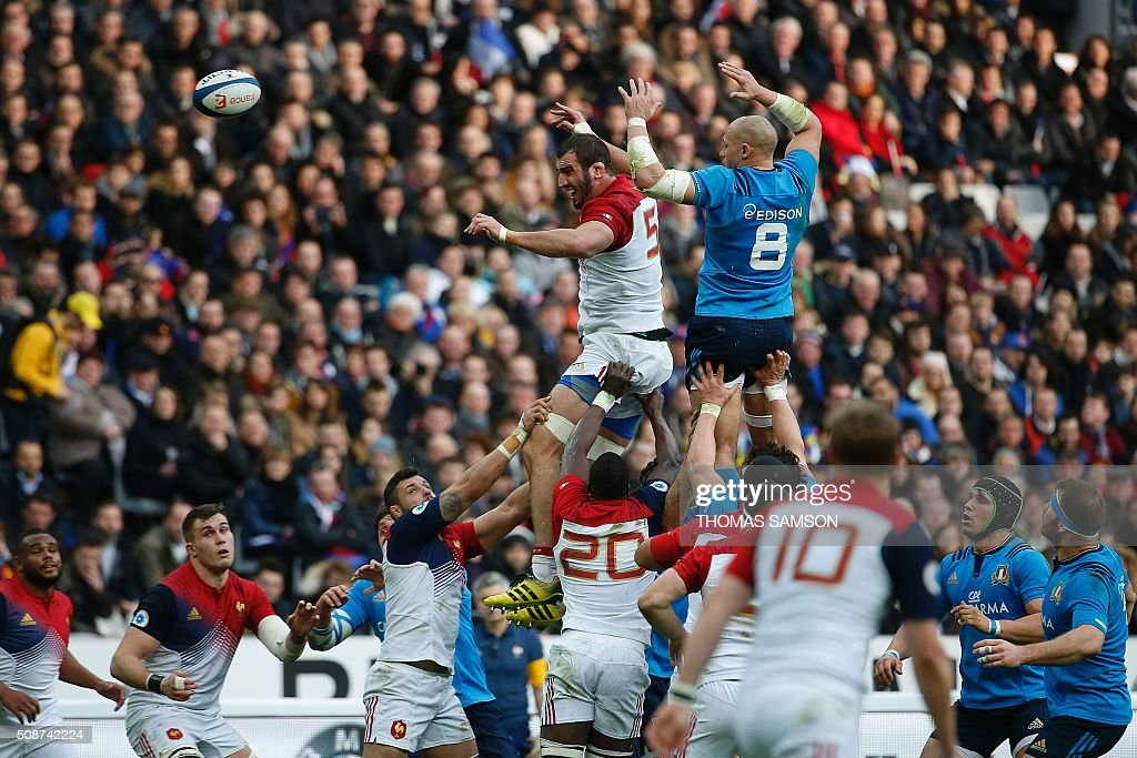 Italy's number 8 and captain Sergio Parisse (R) and France's lock Yoann Maestri (L) jump for the ball in a line out during the Six Nations international rugby union match between France and Italy at the Stade de France in Saint-Denis, north of Paris, on February 6, 2016. AFP PHOTO / THOMAS SAMSON / AFP / THOMAS SAMSON
