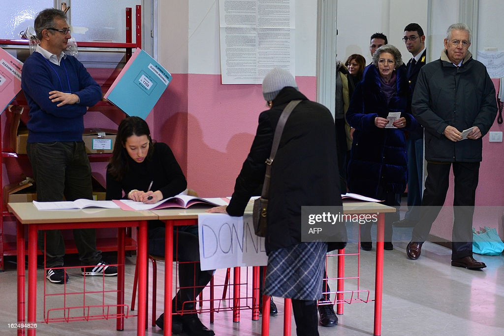 Italy's outgoing Prime Minister Mario Monti (R) and his wife Elsa arrive to cast their ballots in a polling station on February 24, 2013 in Milan. Italians fed up with austerity went to the polls on Sunday in elections where the centre-left is the favourite, as Europe held its breath for signs of fresh instability in the eurozone's third economy.
