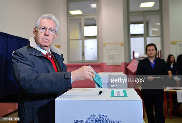 Italy's outgoing Prime Minister Mario Monti casts his ballot in a polling station on February 24 2013 in Milan Italians fed up with austerity went to...