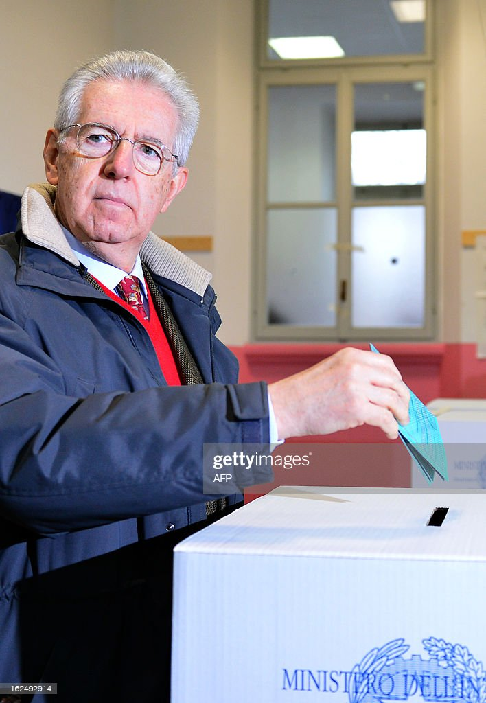 Italy's outgoing Prime Minister Mario Monti casts his ballot in a polling station on February 24, 2013 in Milan. Italians fed up with austerity went to the polls on Sunday in elections where the centre-left is the favourite, as Europe held its breath for signs of fresh instability in the eurozone's third economy. AFP PHOTO / GABRIEL BOUYS