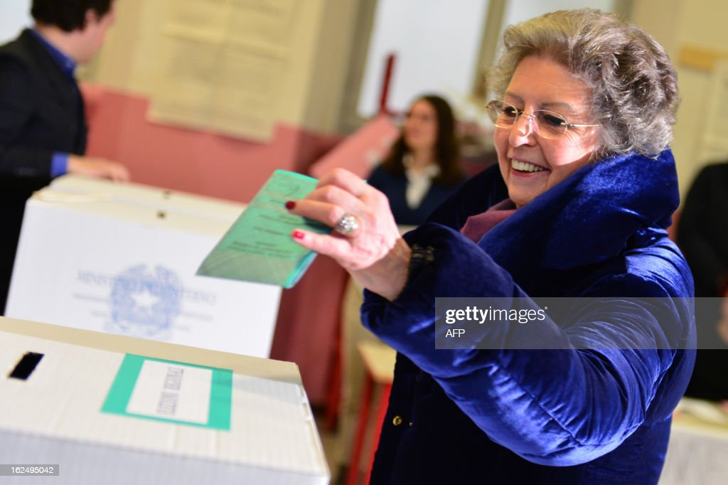Italy's outgoing Prime Minister Mario Monti's wife Elsa casts her ballot in a polling station on February 24, 2013 in Milan. Italians fed up with austerity went to the polls on Sunday in elections where the centre-left is the favourite, as Europe held its breath for signs of fresh instability in the eurozone's third economy.