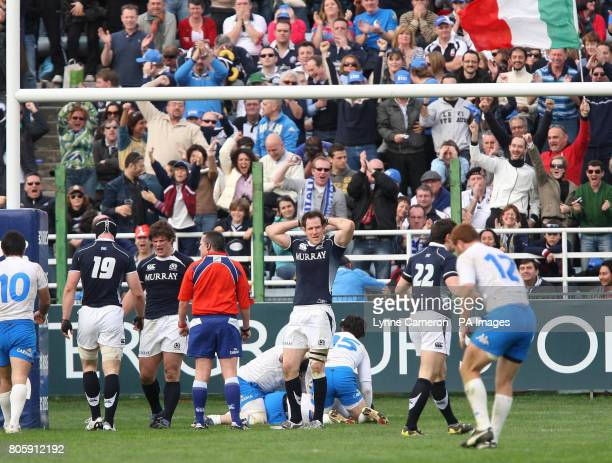 Italy's Pablo Canavosio scores a try between the posts as Scotland's Graeme Morrison and Ross Ford look dejected during the RBS Six Nations match at...